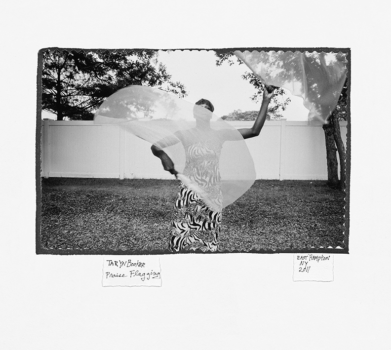 Donna Ferrato. Taryn Booker, a resident at a refuge for victims of domestic violence, practiced a ceremony called praise flagging, an African spiritual practice like an invitation for the Holy Spirit to come inside her. East Hampton, NY 2011 © Donna Ferrato