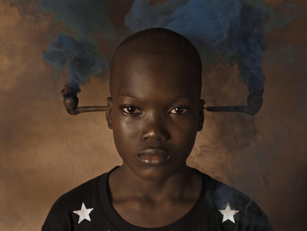 "Cristina de Middel. The Confusion of the Pipe"". Serie: Midnight at the Crossroads. Serie Midnight at the Crossroads. 2018. © Cristina de Middel y Galería Juana de Aizpuru. MAGNUM"